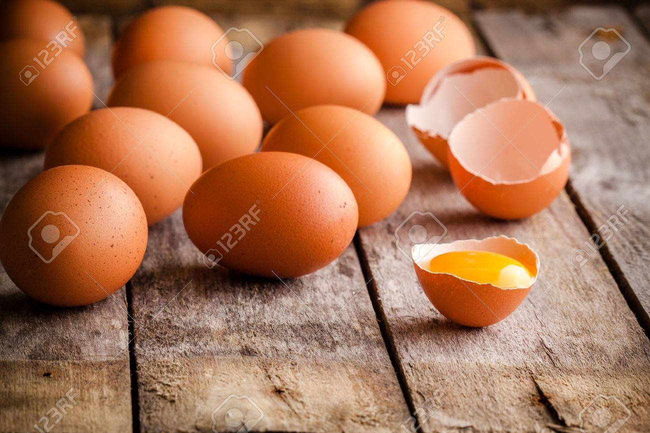 34131527-fresh-farm-eggs-on-a-wooden-rustic-background